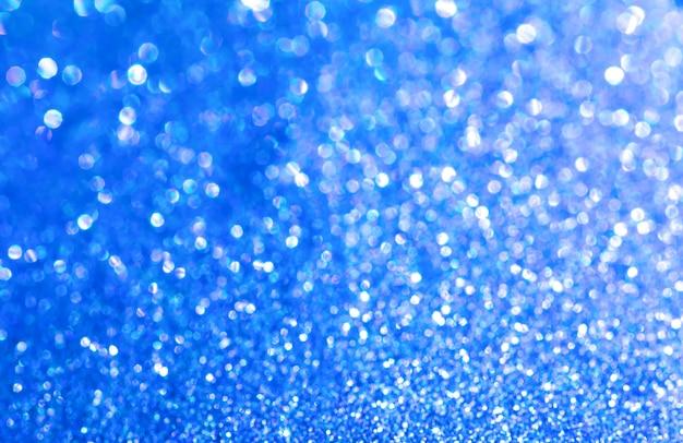 Синий блеск текстуры рождество абстрактный фон. текстура блестящей оберточной бумаги, элемент дизайна поздравительных открыток.