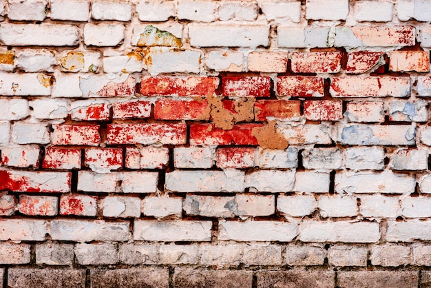 テクスチャ、レンガ、壁、背景として使用できます。傷や亀裂のあるレンガの質感