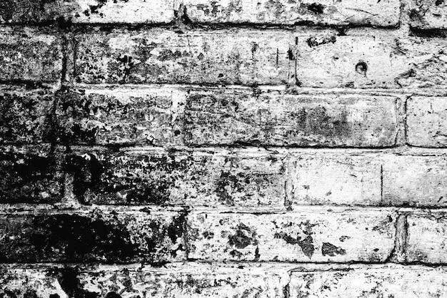 背景として使用できる亀裂や傷のあるレンガの壁のテクスチャ