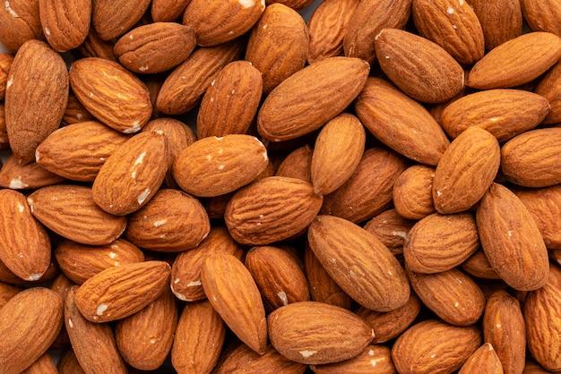 アーモンドナッツをクローズアップ。朝食、健康食品。背景として使用することができます