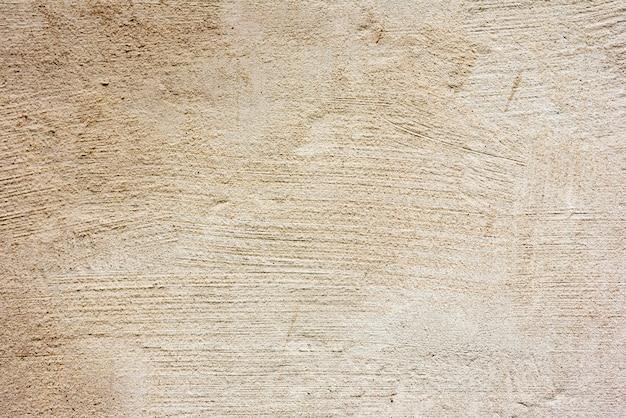 傷や亀裂の背景を持つ壁の断片