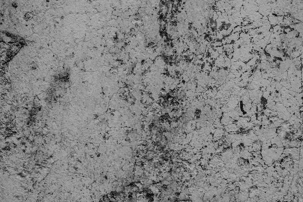 Бетонная стена с трещинами и царапинами