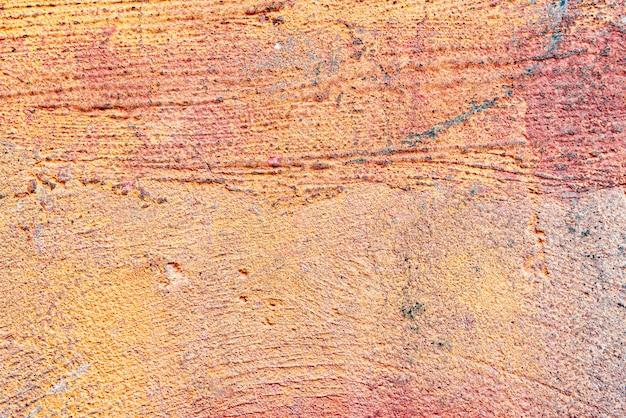 ひび割れや傷のあるコンクリートの壁のテクスチャ
