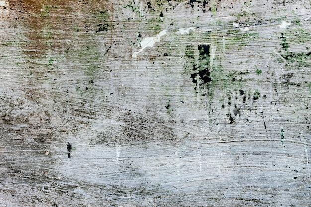 Текстура бетонной стены с трещинами и царапинами