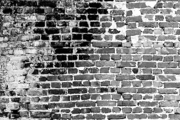 テクスチャ、レンガ、壁の背景。傷やひび割れのあるレンガの質感