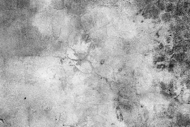 背景として使用できる亀裂や傷のあるコンクリートの壁のテクスチャ