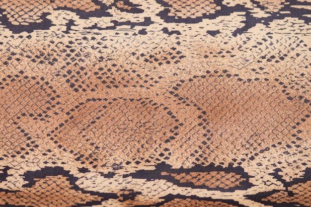 蛇皮の背景、クローズアップ、ベージュと茶色の質感