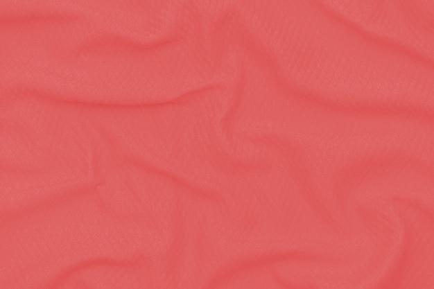 Абстрактная красная, предпосылка текстуры ткани коралла. ткань мягкая волна. закройте, задрапированный.