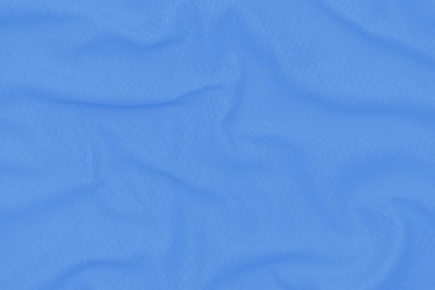 Абстрактная неоновая голубая предпосылка текстуры ткани. ткань мягкая волна. закройте, задрапированный.