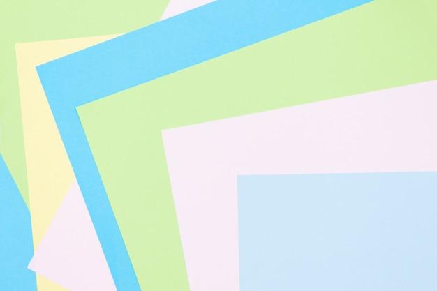 Синий, розовый, зеленый пастельные цвета бумаги геометрические плоские лежал фон. копировать пространство