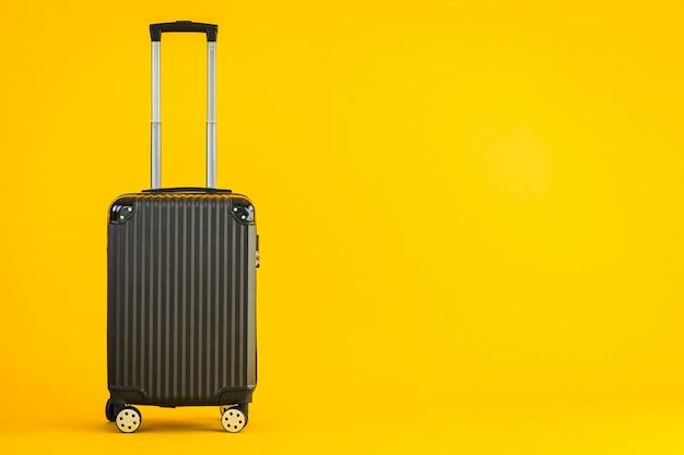 輸送旅行のための黒色の荷物または手荷物バッグの使用