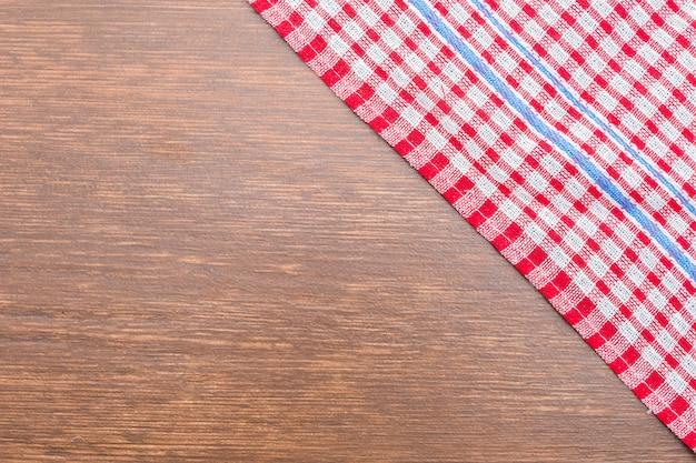 木製の背景にテーブルクロス