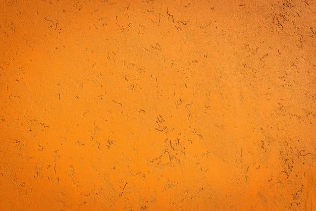 古いオレンジ色の壁の背景