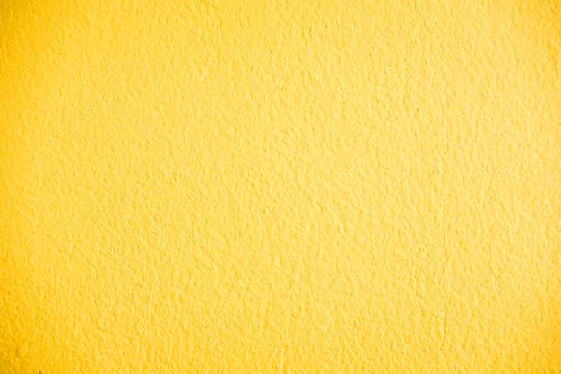 黄色のコンクリート壁のテクスチャ