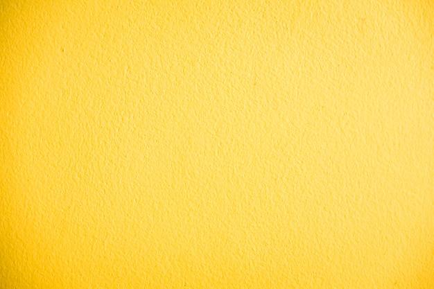 黄色のコンクリートの壁のテクスチャ