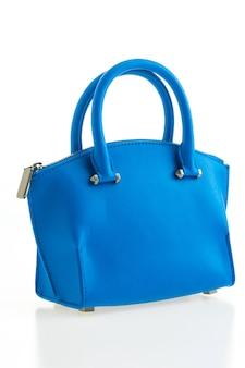 美しい優雅さと高級ファッションの女性と青いハンドバッグ