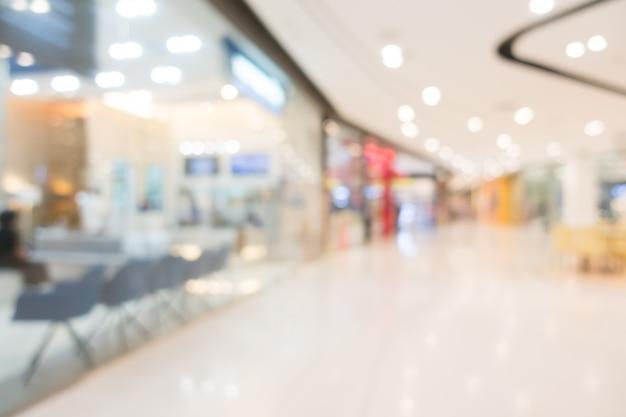 抽象的なぼかしショッピングモールと小売店