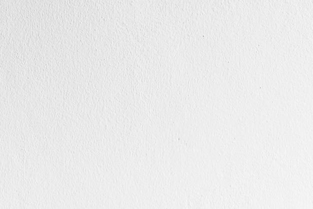 抽象的な白とグレーのコンクリートの壁の質感と表面