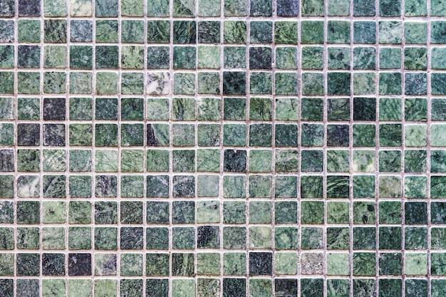 緑のタイル壁のテクスチャと表面