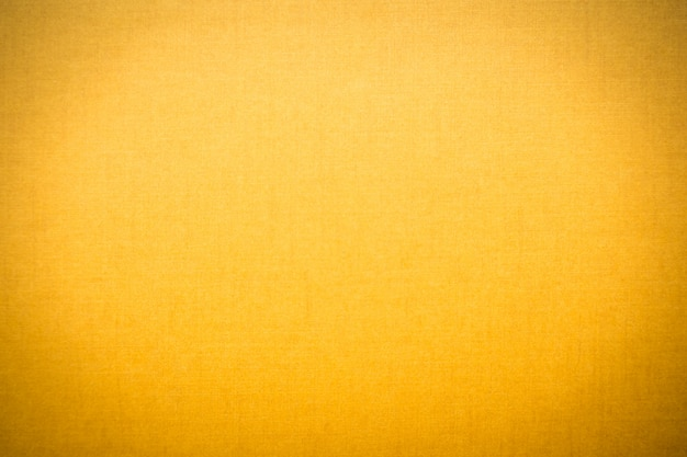 黄色のキャンバスのテクスチャ