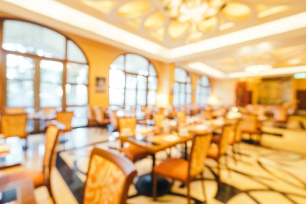 抽象的なぼかしとホテルのレストランやコーヒーショップカフェのインテリアで朝食ビュッフェをデフォーカス