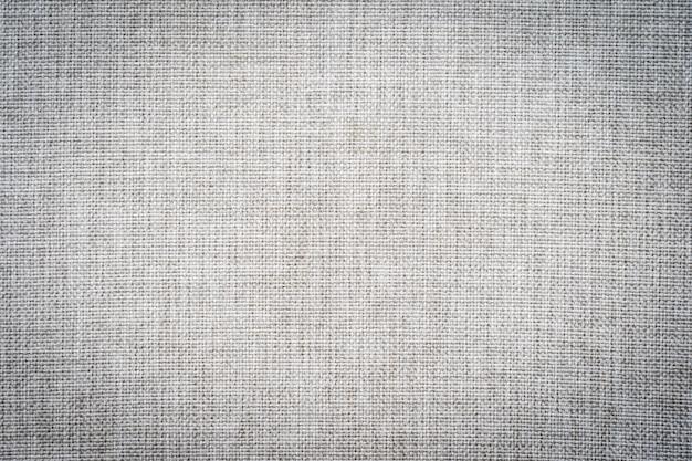 Абстрактные и поверхностные текстуры серой хлопчатобумажной ткани
