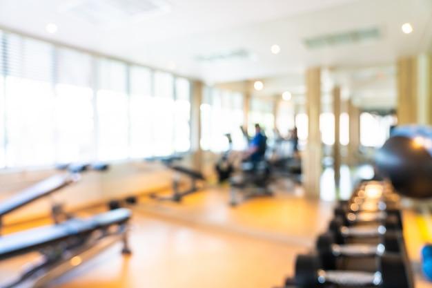 Абстрактное размытие и расфокусировать фитнес-оборудование в интерьере тренажерного зала