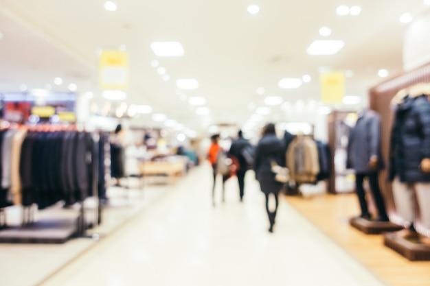 抽象的なぼかしとデパート、ぼやけた写真の背景の多重高級ショッピングモール