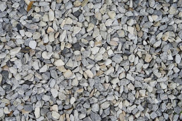 灰色の小石のテクスチャ背景。