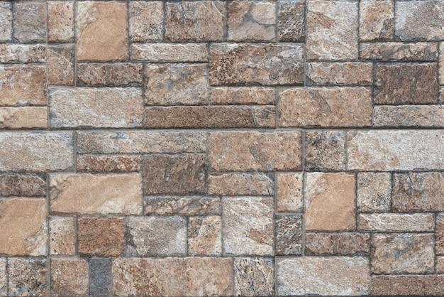 茶色の石のシームレスなテクスチャ - 石のタイルの床舗装の断片。