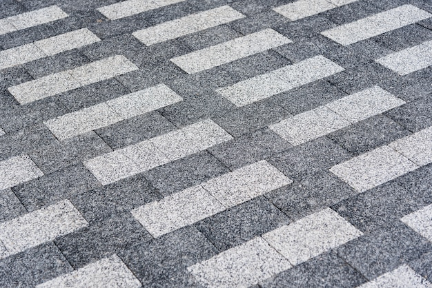 Гранит прямоугольный текстурированный фон. светло-серая и темно-серая напольная плитка.