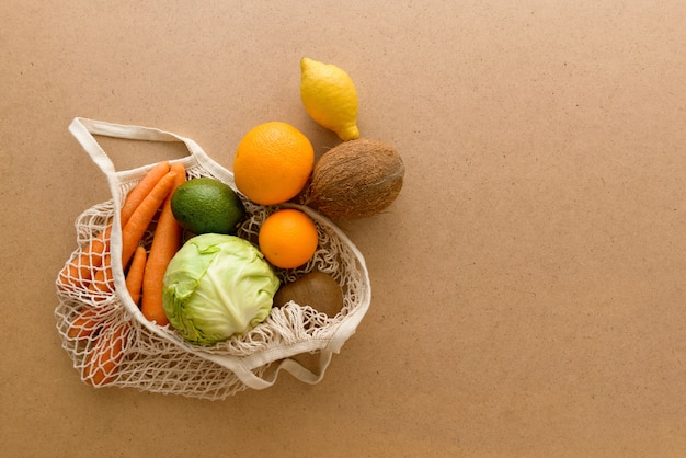 フルーツと野菜が付いている環境に優しい再使用可能な網のひものニットの買い物袋