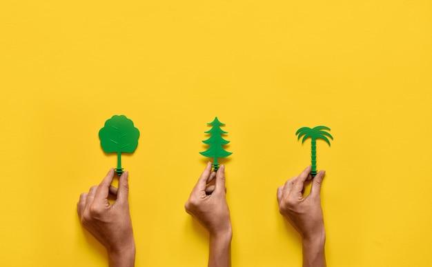 黄色の緑の木々。自然生態フラットレイアウト。コピースペース