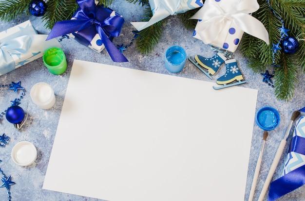 クリスマスは、グリーティングカードや青い色のサンタさんへの手紙のモックアップを作成します。