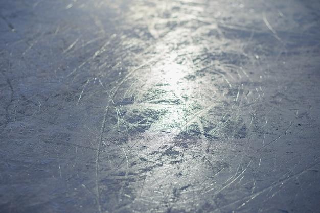 アイススケートリンク、スケート、クローズアップのテクスチャ。オープンアイススケート冬の背景