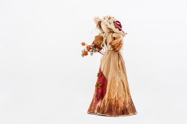 花とトウモロコシの殻人形の手