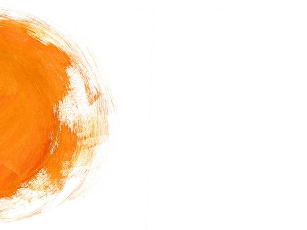 ミニマルなオレンジ色の筆の抽象的な背景