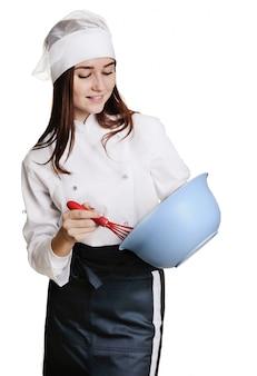 料理泡立て器を持つ少女