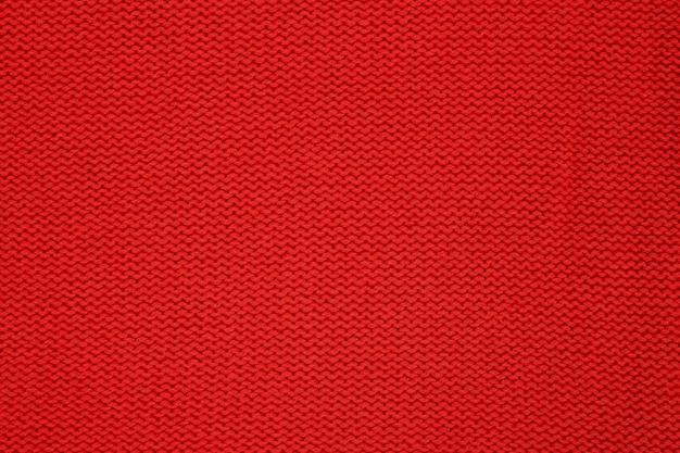 赤いニットのテクスチャ。手作りのニット。バックグラウンド