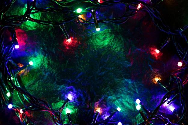 クリスマスの背景にライトとフリーテキストスペース。