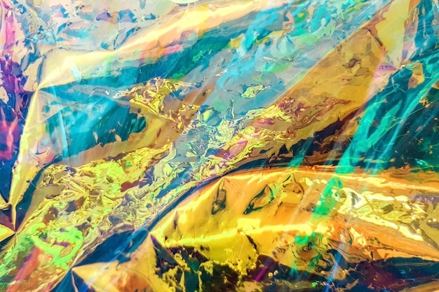 明るい抽象的なホログラフィック背景、テクスチャ。トレンディな背景