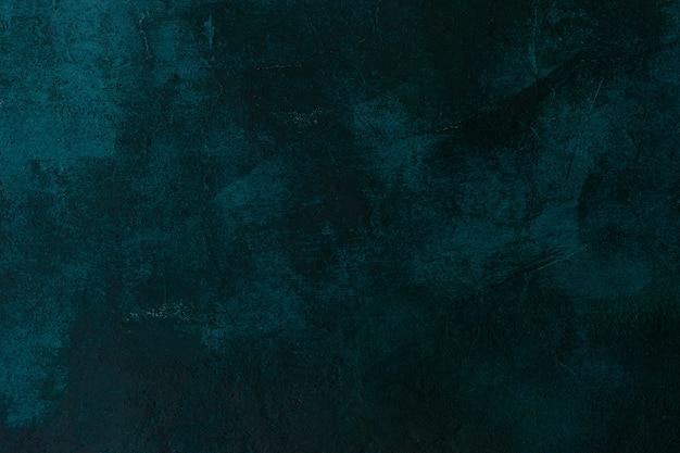 質感のある石造りのコンクリート壁ダークグリーン色