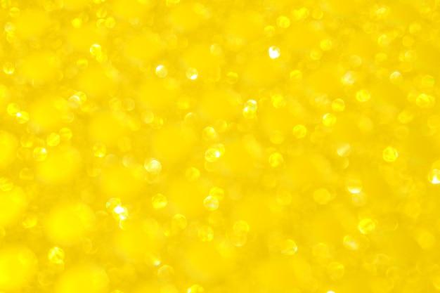 ピンぼけボケライト。輝く黄色の黄金の抽象的な背景やテクスチャ