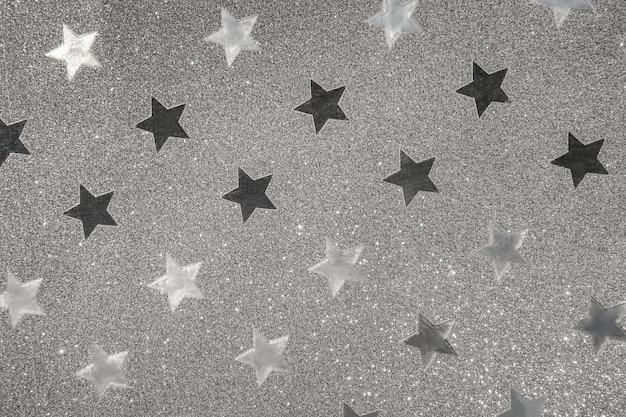 銀の包装紙、背景またはテクスチャとしてちらつき星形
