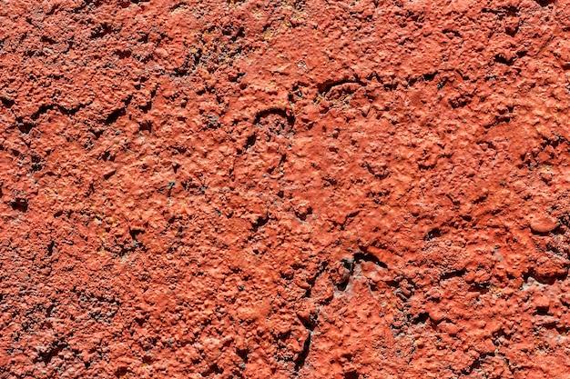 コンクリートの背景はペンキと塗られる。
