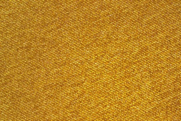 金色の光沢のある生地、背景やテクスチャ