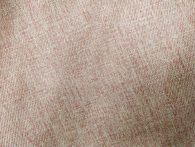 抽象的な茶色の布のテクスチャ背景をクローズアップ