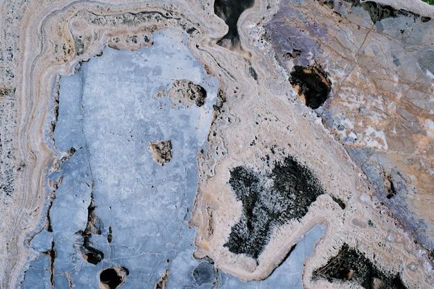 Ржавый коричневый камень текстуры поверхности фона