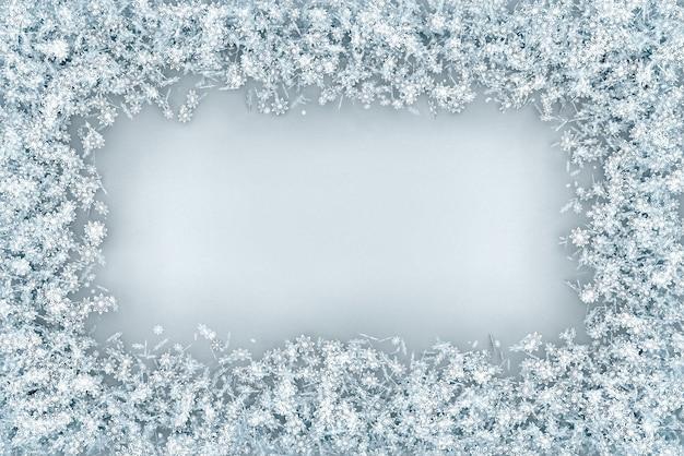 フレームは雪片のセットからボリュームのある長方形です