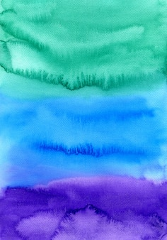 抽象的な水彩画手描きの背景。緑、青、紫の色のカラフルな質感。
